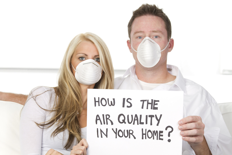 Couple wearing masks due to poor air quality in home